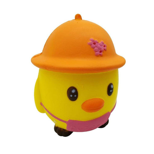 A yellow round chicken squishy with a pink overall and an orange hat with three pink flowers.