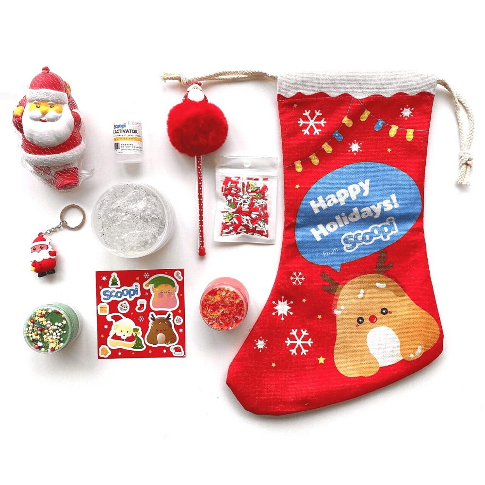 The Christmas stocking contents: a Christmas branded stocking, one Santa squishy, a Santa keychain, a sheet of stickers, two mini slimes, a pack of sprinkles and a green christmas pen