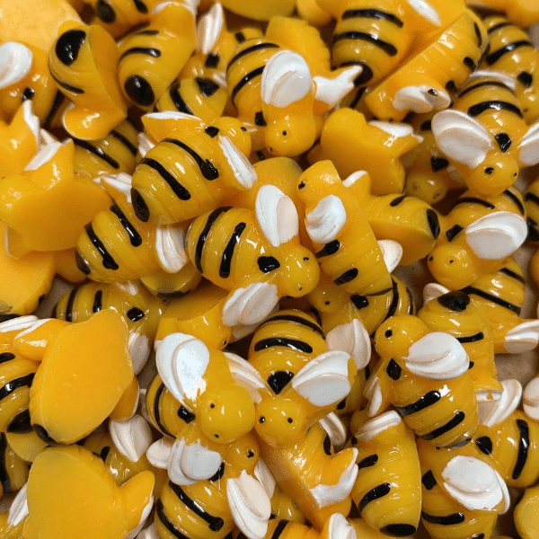 A mix of yellow bee charms