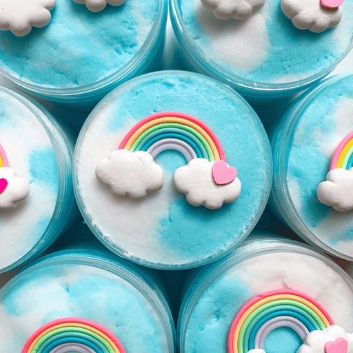 Several white and blue cloud slimes decorated with a charm of a colorful rainbow with two clouds and a small pink heart on the right.