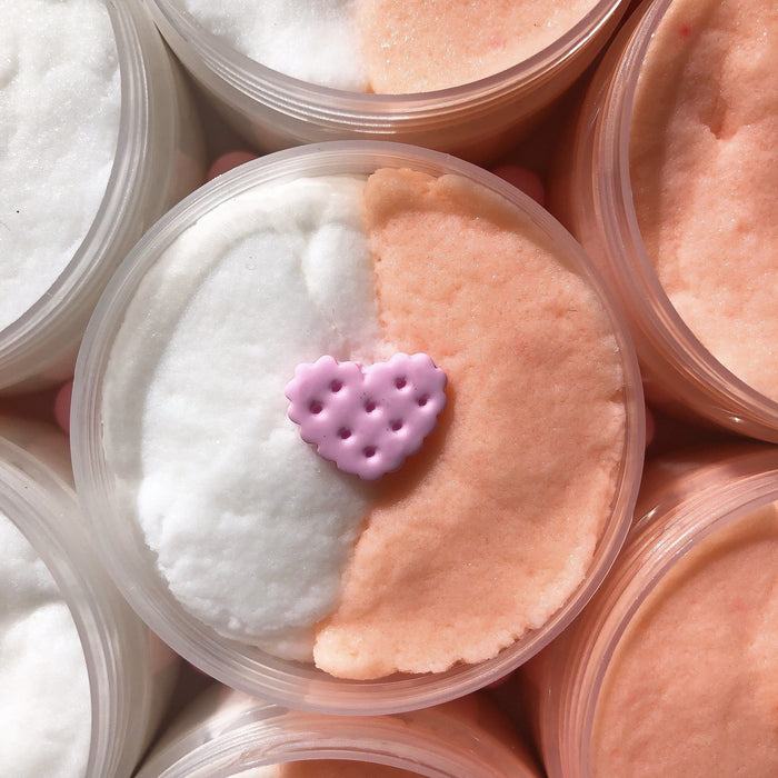 Cloud slime, divided in two colours: half white and half light orange. Scented like marshmallow and strawberry. Has a pink heart shaped cookie charm as a decoration.