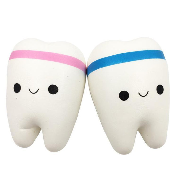Two white teeth squishies one with a pink band and the other with a blue band