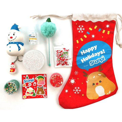 The Christmas stocking contents: a Christmas branded stocking, one snowman squishy, a snowman keychain, a sheet of stickers, two mini slimes, a pack of sprinkles and a green christmas pen