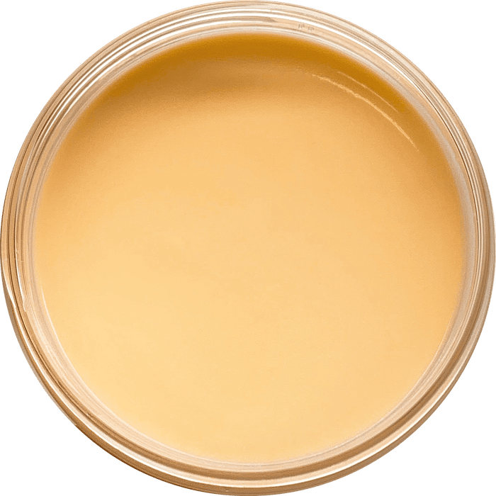 Peach cream slime in its container viewed from the top.