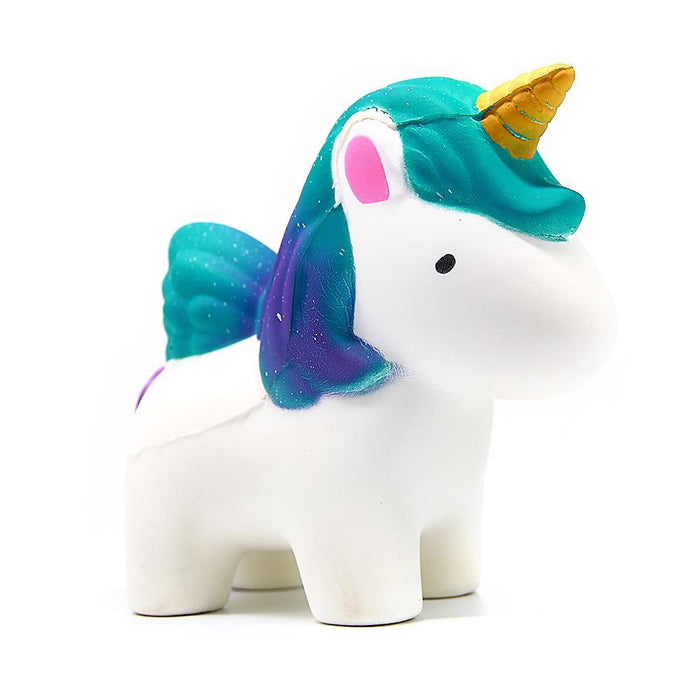 A white unicorn squishy with a golden horn and gradient turquoise to purple hair.