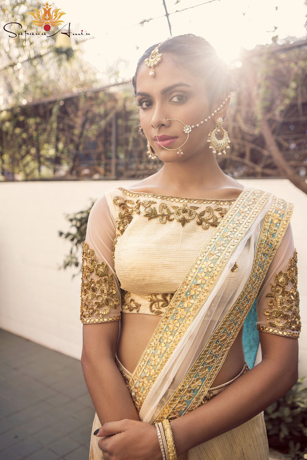 Ivory tea-length lehenga with turquoise border