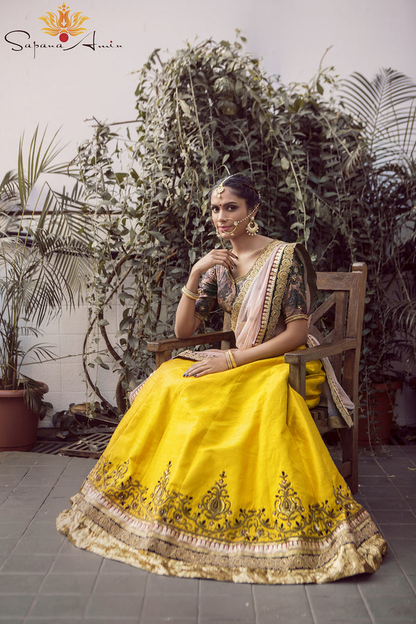 Abstract print blouse, mustard paneled lehenga