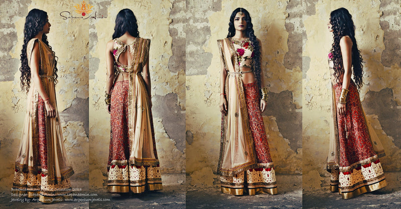 Ivory floral blouse, red tribal print lehenga
