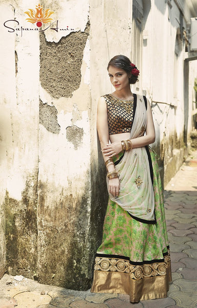 Black brocade blouse, green floral lehenga
