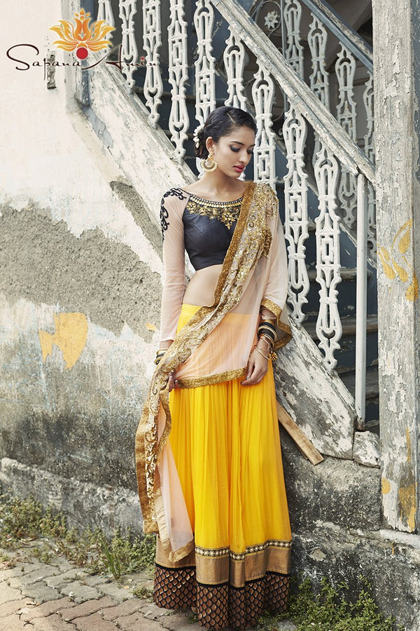 Black blouse, mango orange lehenga