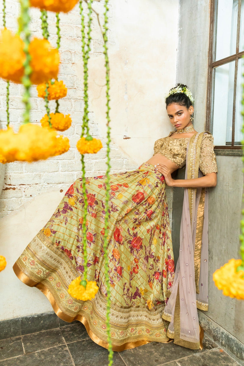Gold embroidered blouse, pistashio green lehenga