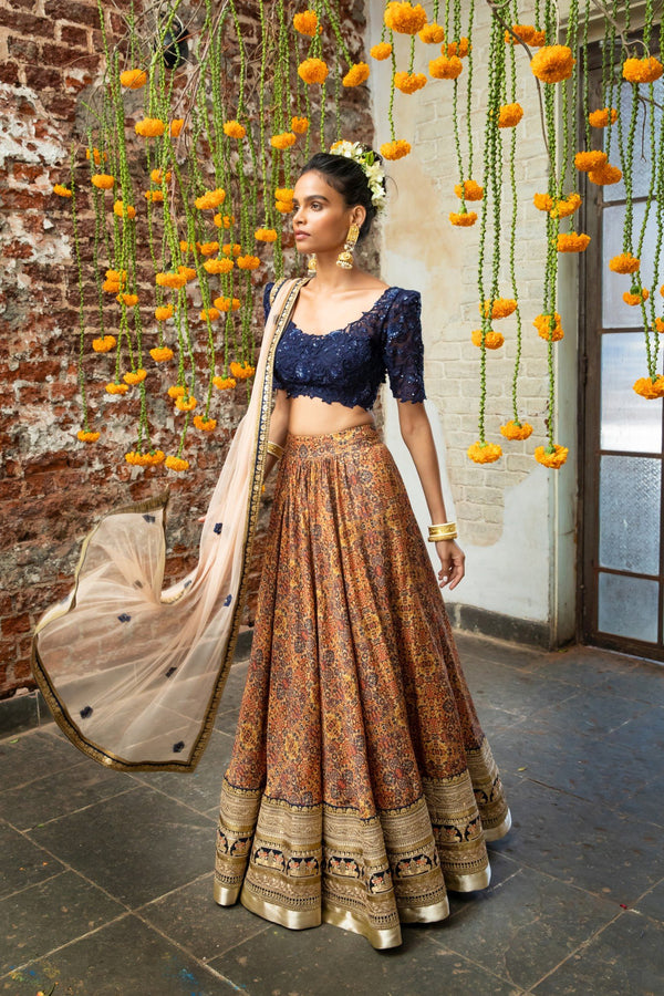 Navy blue blouse, orange tribal print lehenga