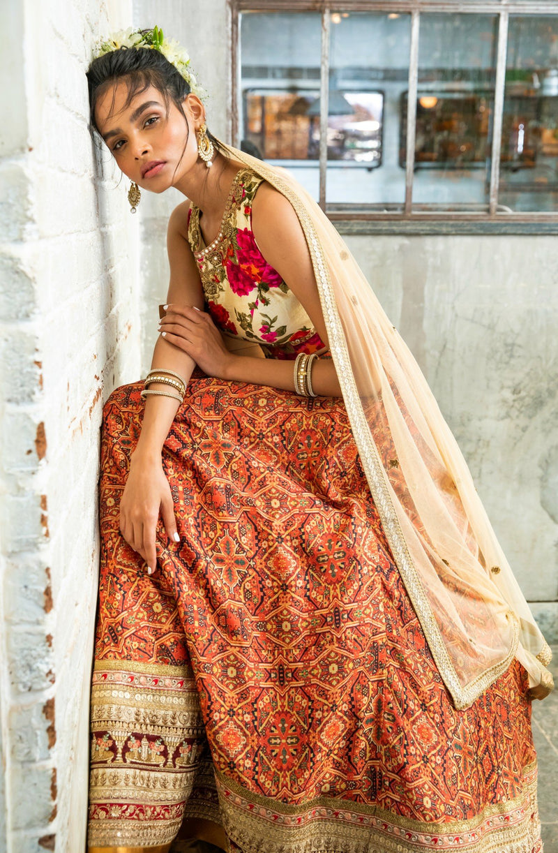 Cream silk blouse, red tribal print lehenga