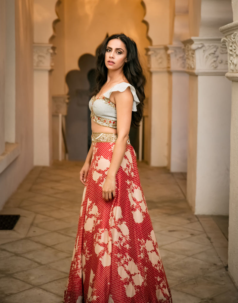Black & white checkered blouse, cherry red floral/polka dot lehenga