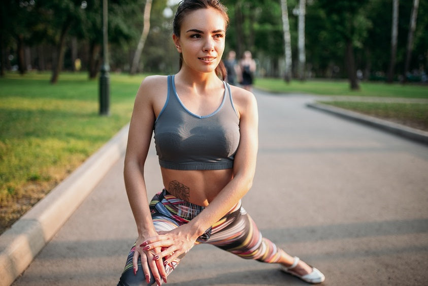 Losing weight with Ashwagandha is popular - Sporty woman stretches