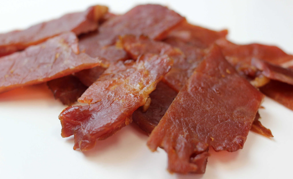 super tender and juicy pork jerky made with lean Berkshire pork that simply marinaded and dried and smoked naturally for a simple and clean best tasting jerky that's keto and paleo friendly