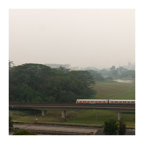 Train passing through on a hazy day