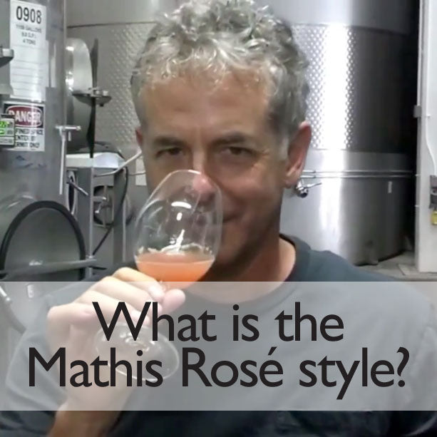 Smelling rosé juice in glass