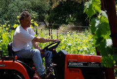 Peter Mathis on tractor at Mathis Vineyard