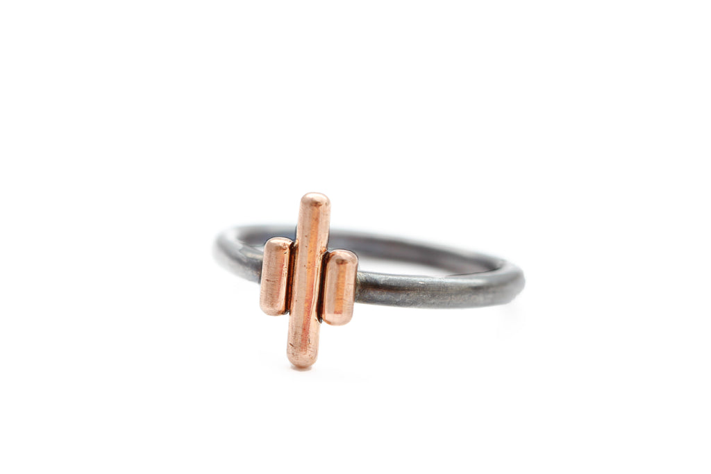 Oxidized sterling silver ring with rose gold bars