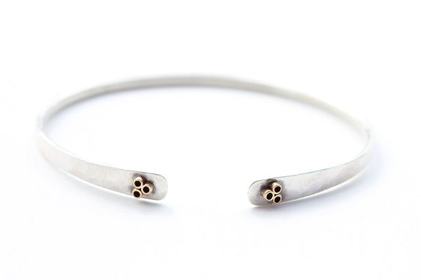 Hammered Sterling Silver Bracelet With 14k Gold flower tubes