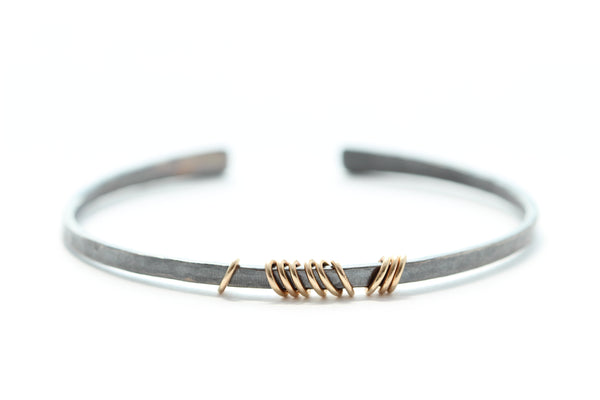 Sterling silver bracelet with 14k gold rings