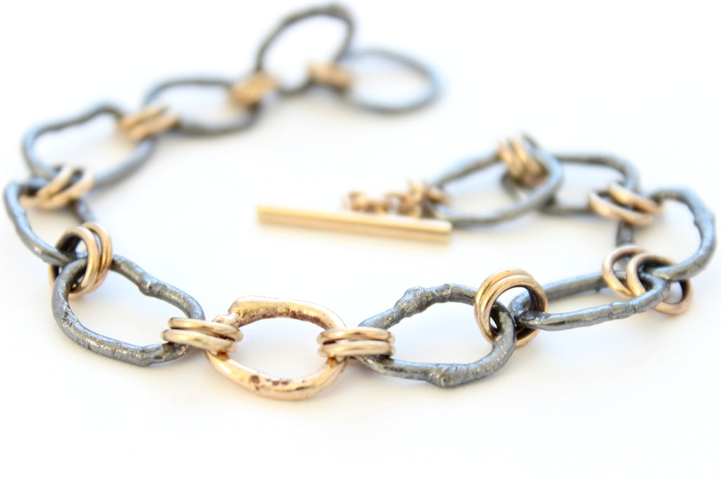 Oxidized sterling silver and gold toggle bracelet