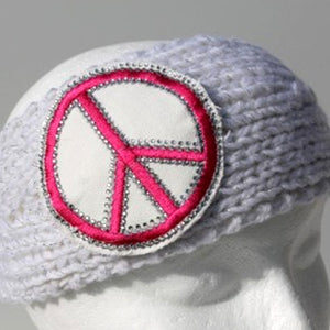 White knit head wrap with large pink peace sign