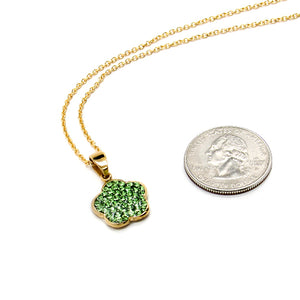 Gold chain with bright green rhinestone flower shaped charm