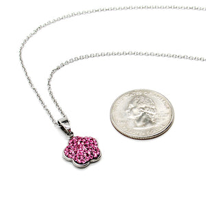 Silver chain with pink colored rhinestone flower shaped charm