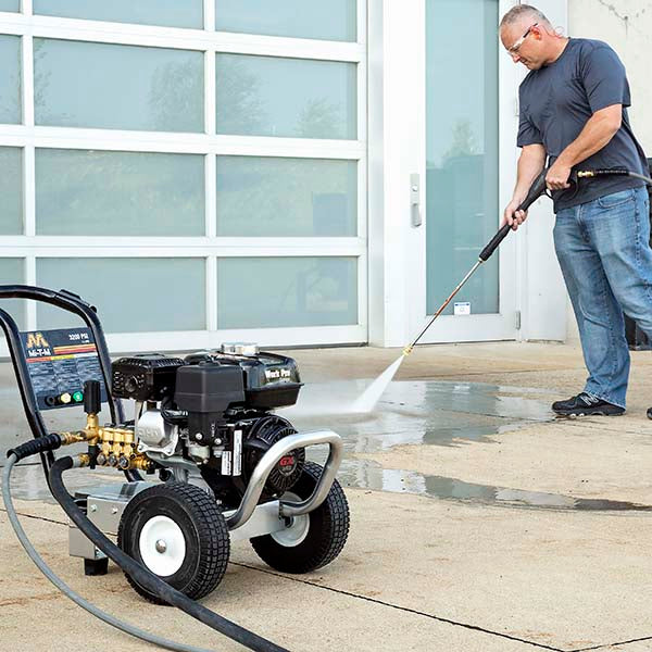 A man using a MiTM pressure washer outside.