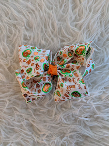White Halloween Bow with Orange and Green Accents
