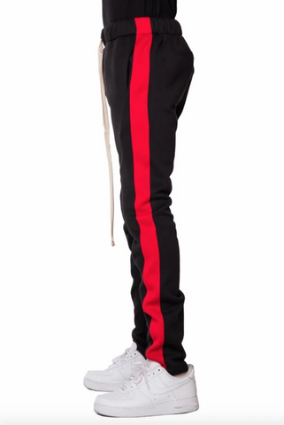 Black and  red single stripe fleece track pants by eptm - Mansion Boutique, Durham, NC