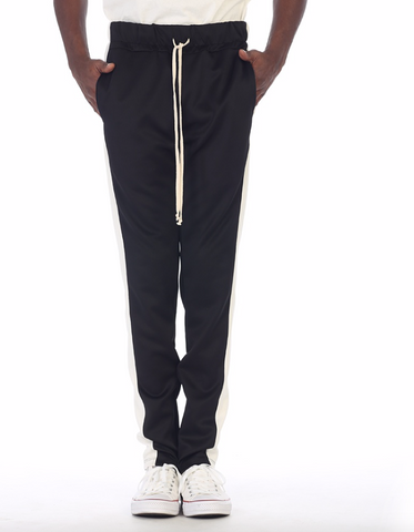 Black track pants with white stripe by eptm - Mansion Boutique, Durham, NC