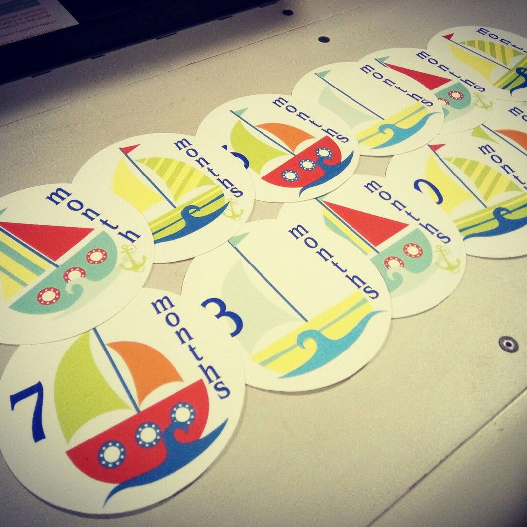 Monthly baby stickers. Sailboats bodysuit infants month labels.