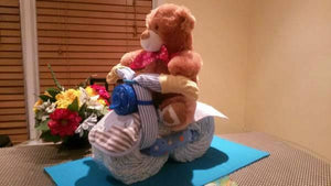 Bicycle Diaper Cake. Neutral baby shower centerpiece. Almost any plush toy as a biker