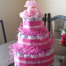 Baby Girl pink Diaper Cake. The diaper cake is adorable and you'll love it