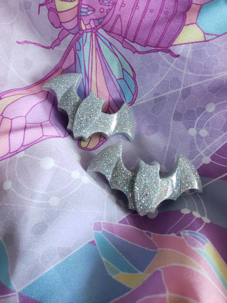 One pair holo bat clips