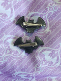 One pair black bat clips