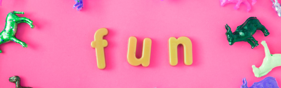 fun letters with animal toys on pink table