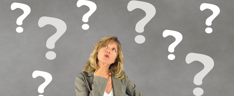 woman looking above at drawn question marks
