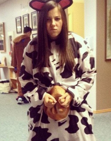 woman wearing a cow costume