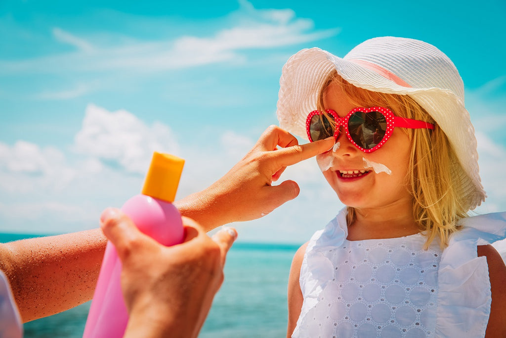 put on sunscreen for kids paddle boarding