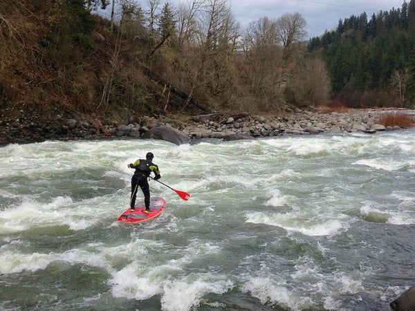 white water paddle boarding