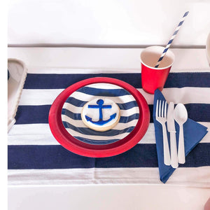 Nautical Party Supplies with navy and white striped plates, red plate, red cup and white cutlery
