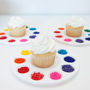 rainbow sprinkles with white cupcake on paint palette