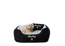 "Small dog bed, black fluffy material personalised with dog name ""Bailey"" in white"
