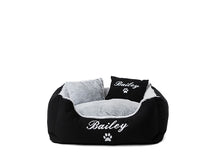 Black fluffy personalised dog bed with white embroidery of dog's name on bed and pillow