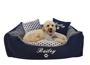"Navy blue and white spotty dog bed with two pillows, personalised with white embroidery of dog name ""Bailey"""