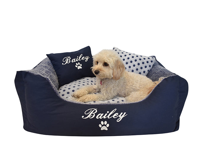 Medium customisable dog bed with navy blue and white spotty design